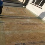 Board under fibreglass during fibreglass roof inastallation 150x150 - Flat Roofing Repairs | Replacement Costs
