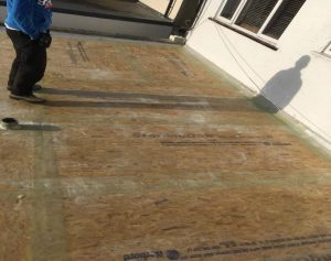 Board under fibreglass during fibreglass roof inastallation 300x237 - Flat Roof Repairs